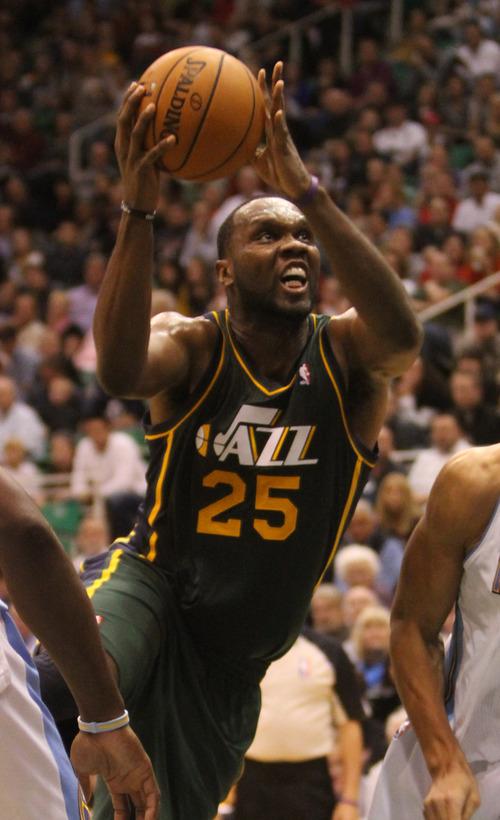 Rick Egan  | The Salt Lake Tribune   Utah Jazz center Al Jefferson (25) takes the ball to the hoop, as Utah defeated Denver 105-103 in NBA action, in Salt Lake City, Monday, November 26, 2012.