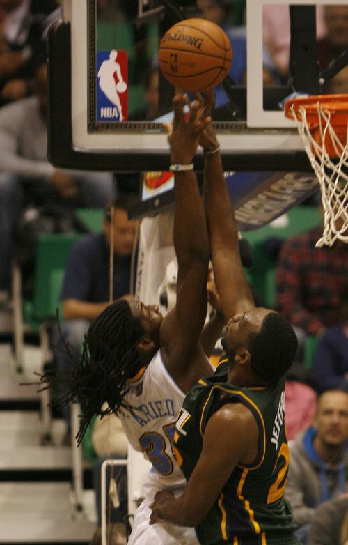 Rick Egan  | The Salt Lake Tribune   Utah Jazz center Al Jefferson (25) defends as Denver Nuggets small forward Kenneth Faried (35) goes up for a shot. Utah defeated Denver 105-103 in NBA action, in Salt Lake City, Monday, November 26, 2012.