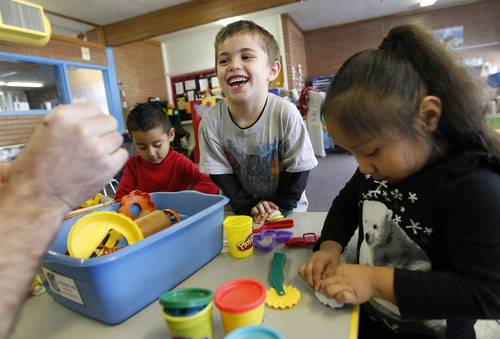 Al Hartmann  |  The Salt Lake Tribune Preschoolers Hector Rosa, left, Gauge Cagle and Jade Mondragon make animals out of play-dough at Neighborhood House.  Neighborhood House has been serving families in Salt Lake City for years and has the state's only accredited, private, year-round nonprofit preschool.