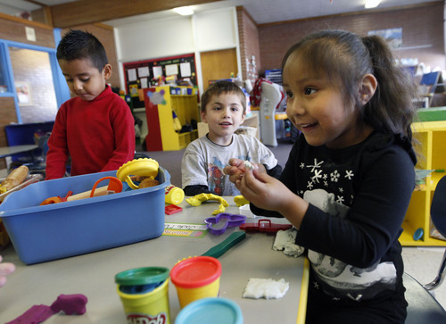 Al Hartmann  |  The Salt Lake Tribune Preschoolers Hector Rosa, left, Gauge Cagle and Jade Mondragon make animals out of play-dough at Neighborhood House.  Neighborhood House has been serving families in Salt Lake City for years, and has the state's only accredited, private, year-round nonprofit preschool.