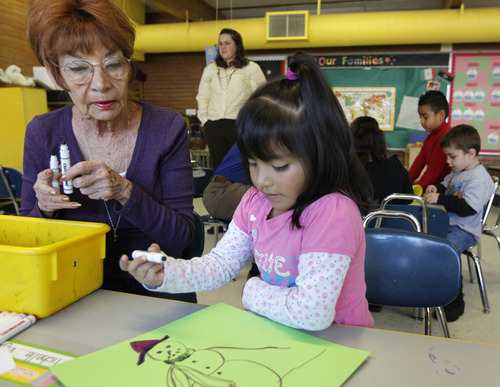 Al Hartmann  |  The Salt Lake Tribune Volunteer Gayle Cowan works with 4-year-old Melanie Martinez on an art project at Neighborhood House. Neighborhood House has been serving families in Salt Lake City for years and has the state's only accredited, private, year-round nonprofit preschool.