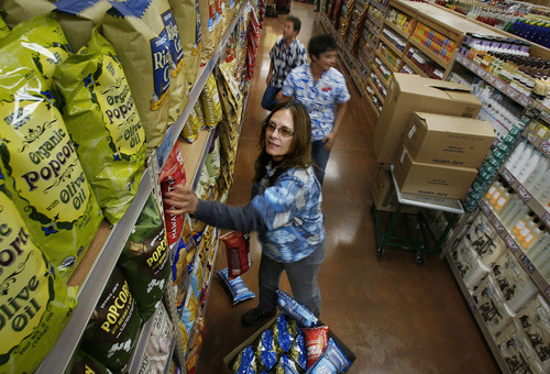 Scott Sommerdorf     The Salt Lake Tribune               Jolene Casano, foreground, and other employees help stock and get the store ready for opening day on Friday, Nov.16, 2012. Utah's first Trader Joe's will open Nov. 30.