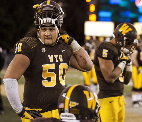 Wyoming defensive tackle Mike Purcell (50) waits out the final seconds in the team's 42-28 loss to San Diego State during an NCAA college football game Saturday, Nov. 24, 2012, in Laramie, Wyo. (AP Photo/Casper Star-Tribune, Kyle Grantham)