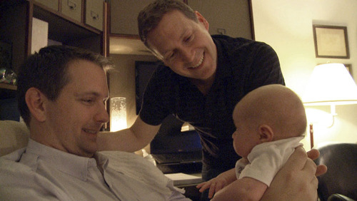 "Gay parents Mark Krieger, left, and Paul Siebold and their daughter, Morgan, who are featured in the Logo TV show ""The Baby Wait."" (Courtesy photo)"