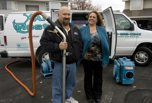 Kim Raff  |  The Salt Lake Tribune Frank and Kris Rudermel, the owners of Anchor Restoration, a Taylorsville carpet cleaning business, are getting guidance from SCORE to expand their company. Taylorsville officials have been matching local residents with SCORE, a nonprofit association that helps small businesses grow, as a way of boosting economic development in the west-side community.