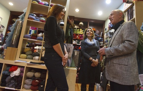 Leah Hogsten  |  The Salt Lake Tribune  Cynthia Mills, (center) owner of Blazing Needles knitting store, and employee Monique Carlson receive business guidance from mentor Ron Baron.