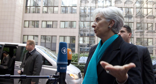 Managing Director of the International Monetary Fund Christine Lagarde, second right, speaks with the media as she arrives for a meeting of eurogroup finance ministers at the EU Council building in Brussels on Monday, Nov. 26, 2012. Eurozone finance ministers are set to meet in Brussels on Monday to discuss the next installment of bailout money for debt-laden Greece. (AP Photo/Virginia Mayo)