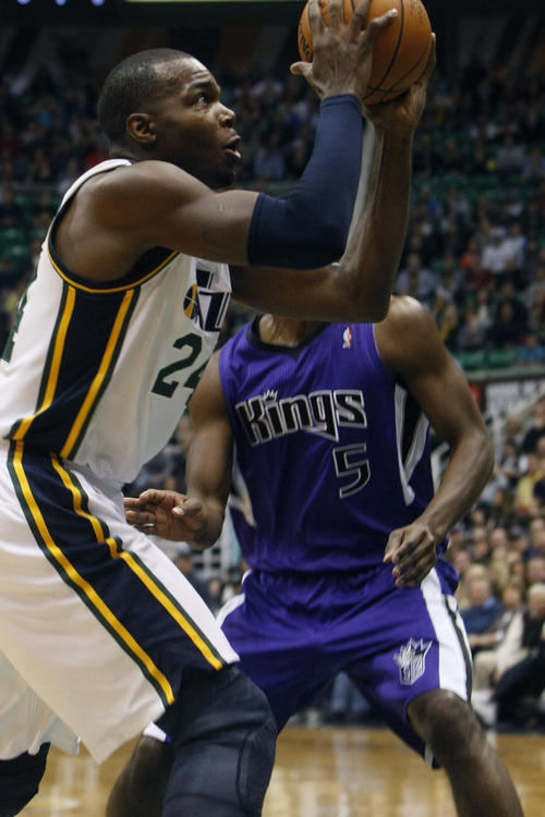 Chris Detrick  |  The Salt Lake Tribune Utah Jazz power forward Paul Millsap (24) shoots past Sacramento Kings small forward John Salmons (5) during the first half of the game at EnergySolutions Arena Friday November 23, 2012.  The Kings are winning the game 53-52.