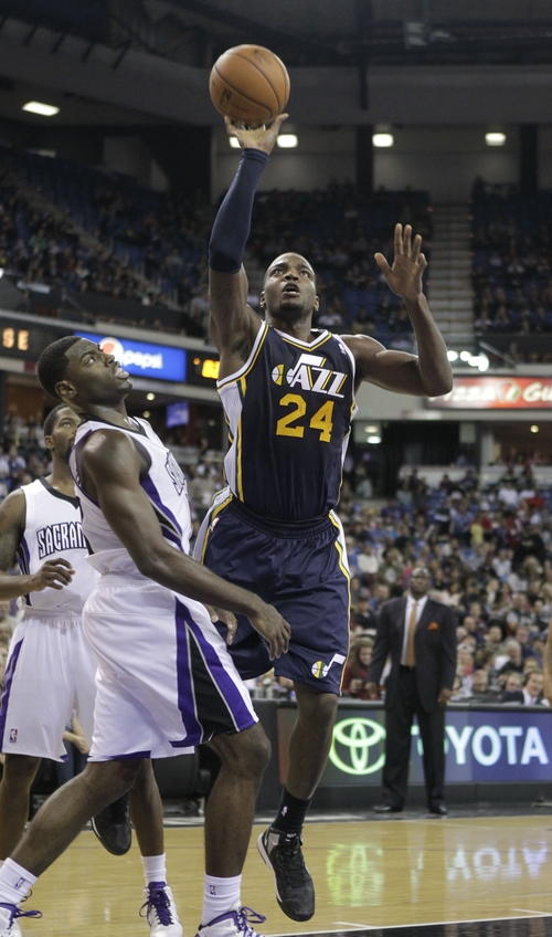 Utah Jazz forward Paul Millsap, left, goes to the basket against Sacramento Kings guard Tyreke Evans  during the second half of an NBA basketball game in Sacramento, Calif., Saturday, Nov. 24, 2012.  The Kings won 108-97.(AP Photo/Rich Pedroncelli)