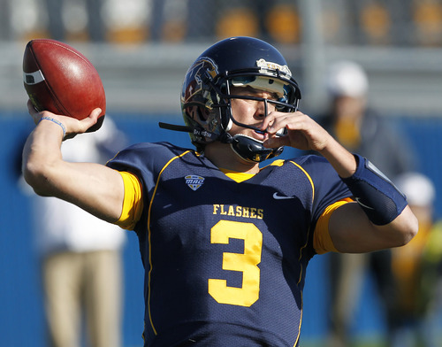 Kent State's Spencer Keith throws a pass against Ohio during the third quarter of an NCAA college football game, Friday, Nov. 23, 2012, in Kent, Ohio. Kent State won 28-6.  (AP Photo/Ron Schwane)