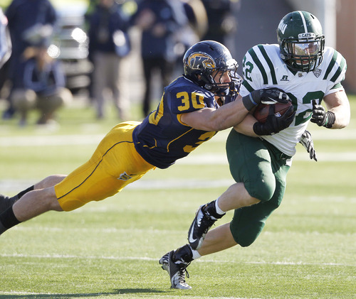 Kent State's Luke Batton tackles Ohio's Beau Blankenship during the third quarter of an NCAA college football game, Friday, Nov. 23, 2012, in Kent, Ohio. Kent State won 28-6.  (AP Photo/Ron Schwane)