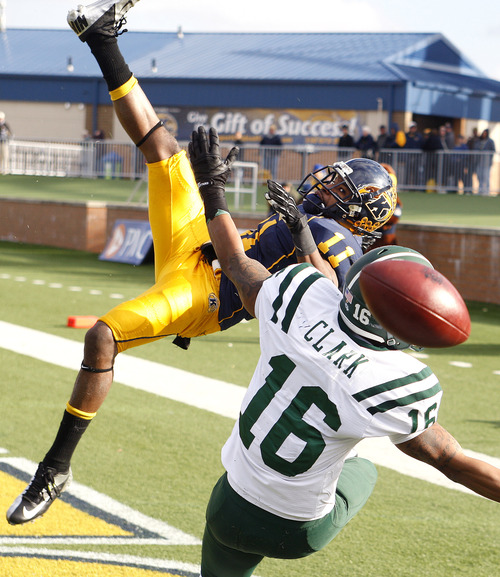 Kent State's Norman Wolfe Jr., let, breaks up a pass intended for Ohio's Ryan Clark during the fourth quarter of an NCAA college football game, Friday, Nov. 23, 2012, in Kent, Ohio. Kent State won 28-6.  (AP Photo/Ron Schwane)
