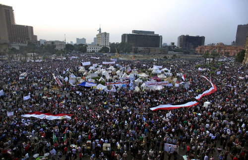 Egyptian protesters attend an opposition rally in Tahrir Square in Cairo, Egypt, Tuesday, Nov. 27, 2012. Thousands flocked to Cairo's central Tahrir square on Tuesday for a protest against Egypt's president in a significant test of whether the opposition can rally the street behind it in a confrontation aimed at forcing the Islamist leader to rescind decrees that granted him near absolute powers. (AP Photo/Khalil Hamra)