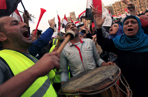 Egyptian protesters chant slogans against President Mohammed Morsi in Tahrir Square in Cairo, Egypt, Tuesday, Nov. 27, 2012. Egyptians flocked to Cairo's central Tahrir square on Tuesday for a protest against Egypt's president in a significant test of whether the opposition can rally the street behind it in a confrontation aimed at forcing the Islamist leader to rescind decrees that granted him near absolute powers.  (AP Photo/Khalil Hamra)