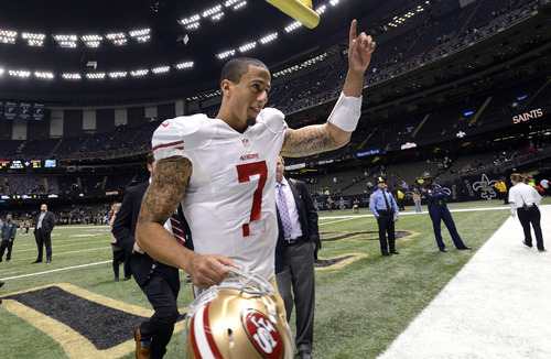 San Francisco 49ers quarterback Colin Kaepernick (7)  gestures after his second start in an NFL football game against the New Orleans Saints in New Orleans, Sunday, Nov. 25, 2012. The 49ers defeated the Saints 31-21. (AP Photo/Bill Feig)