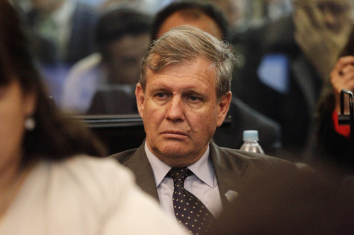 """Former Argentina's navy captain Alfredo Astiz, known as the """"Blonde Angel of Death,""""who was sentenced to life in prison for torture, murder and human rights abuses in October 2011, attends a new trial, in Buenos Aires, Argentina,  Wednesday, Nov. 28, 2012. The third trial for 68 navy officers and civilians accused of human rights abuses believed to have been committed inside the Argentine Navy School of Mechanics began Wednesday. Human rights groups say that more than 5,000 political prisoners passed through its torture chambers and fewer than half survived. The former school is now a museum honoring the victims  (AP Photo/Eduardo Di Baia)"""
