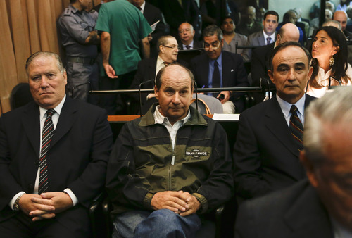 Julio Poch, right, a Dutch national and a former Argentine naval aviator extradited from Spain in 2010, attends a trial in Buenos Aires, Argentina,  Wednesday, Nov. 28, 2012. The third trial for 68 Navy officers and civilians accused of human rights abuses believed to have been committed inside the Argentine Navy School of Mechanics begun Wednesday. Human rights groups say that more than 5,000 political prisoners passed through its torture chambers and fewer than half survived. The former school is now a museum honoring the victims  (AP Photo/Eduardo Di Baia)