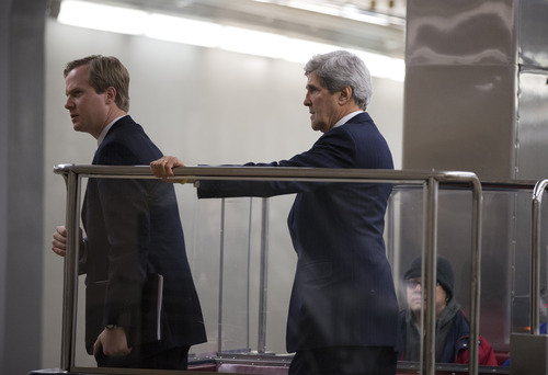 Sen. John Kerry, D-Mass., right, prepares to ride on the U.S. Capitol subway system on Capitol Hill in Washington, Wednesday, Nov. 28, 2012.  (AP Photo/ Evan Vucci)
