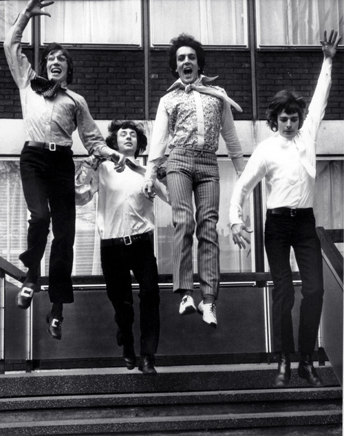 On the threshold of stardom, members of the psychedelic rock band Pink Floyd leap from the steps of EMI House in London March 3, 1967. From left: Roger Waters, Nick Mason, Syd Barrett and Richard Wright. (AP Photo)