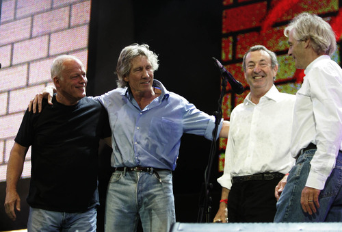 "FILE -This is Saturday July 2, 2005 file photo of  Pink Floyd's Dave Gilmore, left, Roger Waters, second left, Nick Mason, second right, and Rick Wright, at the end of their set  at the Live 8 concert in Hyde Park,  London.  In a victory for the concept album, Britain's High Court on Thursday March 11, 2010 ordered record company EMI Group Ltd. to stop selling downloads of Pink Floyd tracks individually rather than as part of the band's original records. The rock group sued the music label, saying its contract prohibited selling the tracks ""unbundled"" from their original album setting.  (AP Photo/Lefteris Pitarakis, File)"