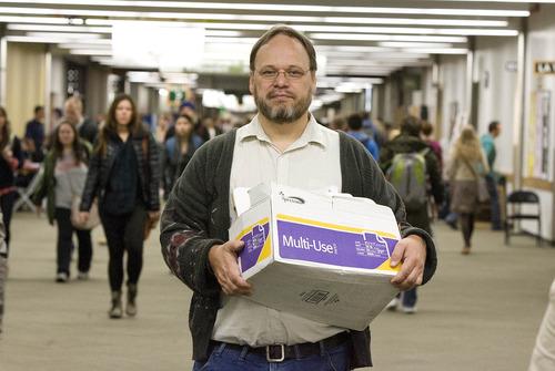 Paul Fraughton | The Salt Lake Tribune Alma Teao Wilson, an adjunct professor of math at Utah Valley University, carries a box of teaching materials as he walks to his quantitative reasoning class.