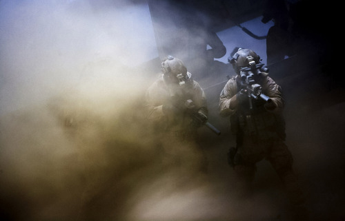 "Navy SEALs fight through a dust storm to pursue Osama Bin Laden in ""Zero Dark Thirty."" Courtesy Columbia Pictures"