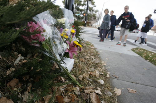 Francisco Kjolseth  |  The Salt Lake Tribune Students visit the makeshift memorial for Elk Ridge Middle School P.E. teacher Randy Treglown, 51, at the intersection where he was struck and killed by a car at the corner of 4000 West and 9800 South as he jogged to work early Wednesday, November 28, 2012.