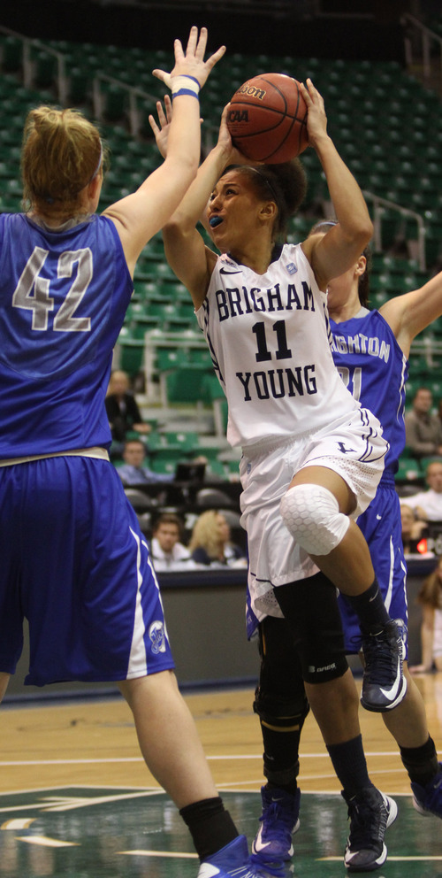 Rick Egan  | The Salt Lake Tribune   Brigham Young Cougars guard Xojian Harry (11) takes the ball to the hoop, as Creighton Bluejays forward Sarah Nelson (42) defends, in basketball action, BYU vs. Creighton, at EnergySolutions Arena,  Wednesday, November 28, 2012.