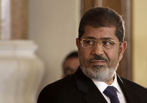 In this Friday, July 13, 2012 photo, Egyptian President Mohammed Morsi holds a joint news conference with Tunisian President Moncef Marzouki, unseen, at the Presidential palace in Cairo, Egypt. Egypt's Islamist president may look like he's running out of options as he faces an appeals court strike and massive opposition protests over decrees granting himself near absolute power. Will he back down now? Most likely not. Mohammed Morsi's next move may be to raise the stakes even higher. Signs are growing the constitutional panel at the heart of the showdown could vote on a draft this week despite a walkout by liberal and Christian members. (AP Photo/Maya Alleruzzo)
