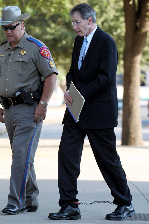 Convicted polygamist leader Warren Jeffs is escorted into the Tom Green County Courthouse, Tuesday, Aug. 9, 2011, in San Angelo, Texas. The jury in Jeffs' sexual assault trial is set to hear closing arguments in the penalty phase of the trial and could issue up to 119 years in prison. (AP Photo/San Angelo Standard-Times, Patrick Dove)