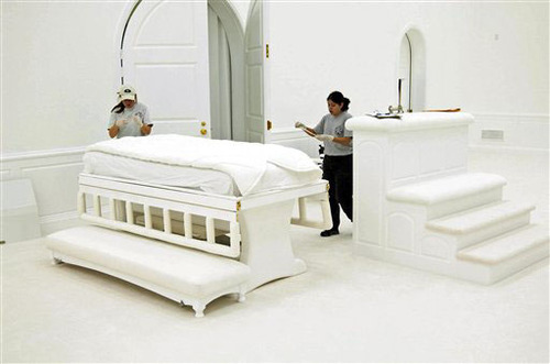 Authorities inside the FLDS temple at the Yearning for Zion Ranch in Eldorado collect evidence following a 2008 raid on the ranch. Shown are temple beds. This photo was entered as evidence in the Warren Jeffs trial. Prosecutors alleged Jeffs had sex with underage child brides inside the temple and ordered construction of a table that could be transformed into a bed with a plastic-covered mattress. Courtesy Image