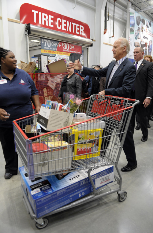 (AP Photo/Susan Walsh) Vice President Joe Biden walks over to hug Costco employee Ivey Stewart, left, after shopping at the a Costco store in Washington, Thursday, Nov. 29, 2012. Biden went shopping for presents and to highlight the importance of renewing middle-class tax cuts so families and businesses have more certainty at this critical time for our economy.