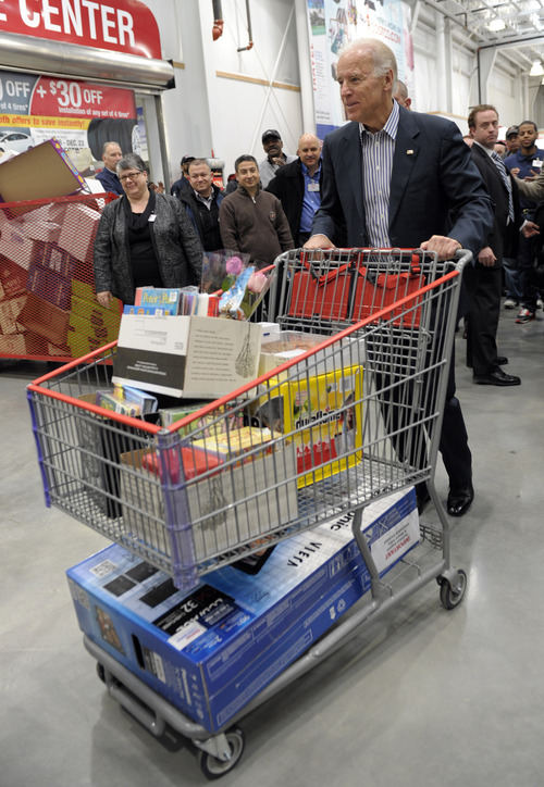 (AP Photo/Susan Walsh) Vice President Joe Biden shopped for holiday presents Thursday at a Costco in Washington, D.C., to highlight the inmportance of retail sales and to call attention to renewing middle-class tax cuts so families and businesses have more certainty as the year draws to a close.
