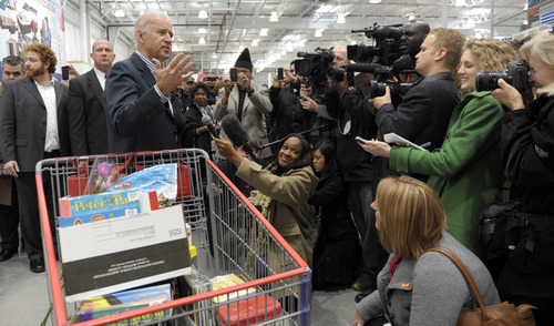 Vice President Joe Biden gestures as he talks to reporters as he pushes his cart after shopping at Costco in Washington, Thursday, Nov. 29, 2012. Biden went shopping for presents and to highlight the importance of renewing middle-class tax cuts so families and businesses have more certainty at this critical time for our economy. (AP Photo/Susan Walsh)