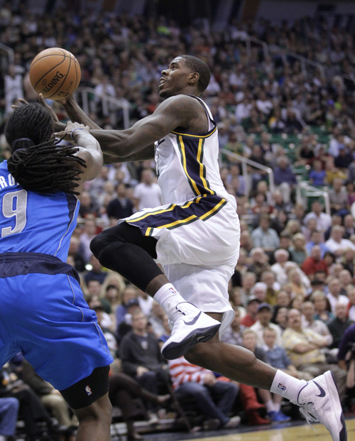 Utah Jazz forward Marvin Williams drives to the basket as Dallas Mavericks forward Jae Crowder (9) defends during the fourth quarter of an NBA basketball game Wednesday, Oct. 31, 2012, in Salt Lake City. (AP Photo/Rick Bowmer)