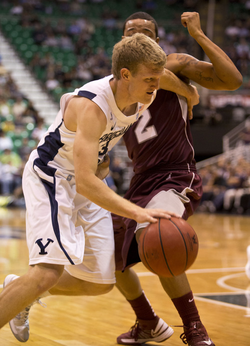 Lennie Mahler  |  The Salt Lake Tribune BYU's Tyler Haws drives around Montana's Kevin Henderson in the Cougars' 85-60 win over the Grizzlies at EnergySolutions Arena, Wednesday, Nov. 28, 2012.