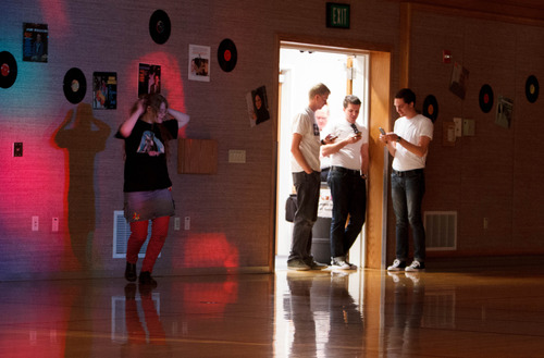 Trent Nelson  |  The Salt Lake Tribune A young woman dances by herself as three eligible bachelors check their phones at a dance at the Salt Lake University Institute of Religion, Friday November 16, 2012 in Salt Lake City.