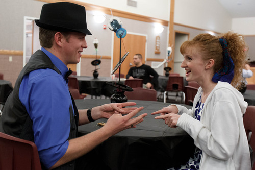 Trent Nelson  |  The Salt Lake Tribune Chase Page and Aly Stephenson play a game Page learned on his LDS mission to Chile at a dance at the Salt Lake University Institute of Religion, Friday November 16, 2012 in Salt Lake City.