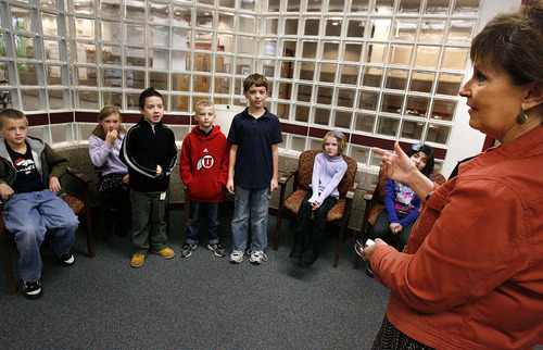 """Scott Sommerdorf     The Salt Lake Tribune               Principal Karen Thomson awards this month's """"The Leader in Me"""" winners at Falcon Ridge Elementary, Monday, November 21, 2011. They are from left to right: Daniel Rich, Kiera McEwen, Dylan, Chesworth, Weston Schmelter, Bryce Doerr, Shaelyn Muncey, and Valerie Uribe. This school year is its second to implement """"The Leader in Me"""" program - it's Franklin Covey's educational program in which kids are taught daily how to use the """"7 habits of highly successful people."""""""