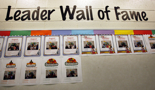 """Scott Sommerdorf     The Salt Lake Tribune              Each month's """"The Leader in Me"""" winners are displayed in photographs in the lobby at Falcon Ridge Elementary, Monday, November 21, 2011. This school year is its second to implement """"The Leader in Me"""" program - it's Franklin Covey's educational program in which kids are taught daily how to use the """"7 habits of highly successful people."""""""