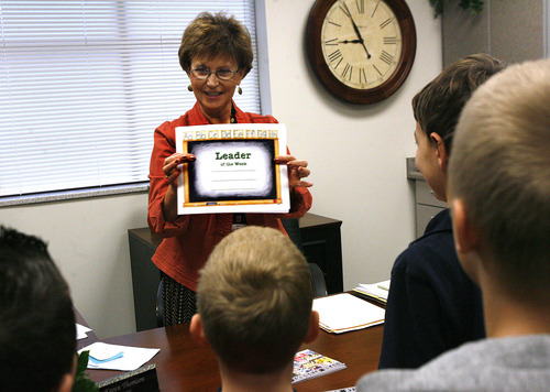 """Scott Sommerdorf     The Salt Lake Tribune               Principal Karen Thomson shows the certificate each winner will get as she awards this month's """"The Leader in Me"""" winners at Falcon Ridge Elementary, Monday, November 21, 2011. This school year is its second to implement """"The Leader in Me"""" program - it's Franklin Covey's educational program in which kids are taught daily how to use the """"7 habits of highly successful people."""""""