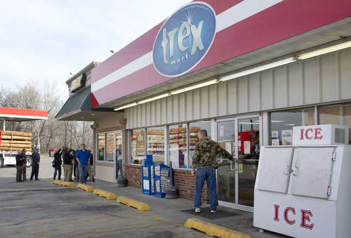 A customer enters Trex Mart as members of the news media gather in Dearborn, Mo., Thursday, Nov. 29, 2012. Trex Mart sold one of last night's winning Powerball tickets. (AP Photo/Orlin Wagner)