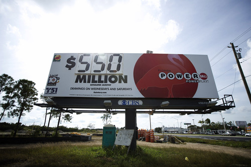 A sign showing the new Powerball jackpot amount stands beside US 1 highway in Homestead, Fla., Wednesday, Nob. 28, 2012. The Powerball jackpot has climbed to $550 million, the second-largest payout in U.S. history. Tickets are selling at a rate of 130,000 a minute nationwide. That's about six times the volume from a week ago. (AP Photo/J Pat Carter)