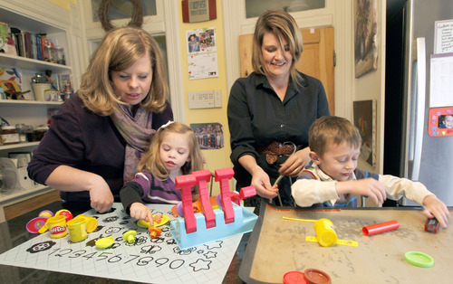 "Al Hartmann  |  The Salt Lake Tribune Lindsay Bartholomew, left, and Jennifer Levy play in the kitchen with their four-year-olds Emma and Hudson. The women run ""Utah Easy to Love"" a support group for families raising children with special needs. They hold monthly groups in Salt Lake City and Layton. Groups have topics, information, group speakers and support for families."