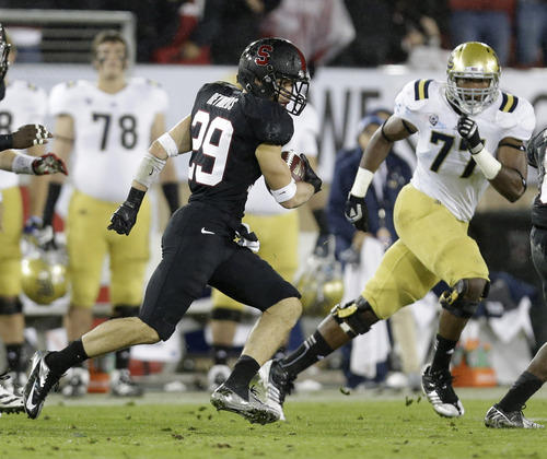 Stanford safety Ed Reynolds (29) returns an interception for 80 yards against UCLA during the first half of the Pac-12 championship NCAA college football game in Stanford, Calif., Friday, Nov. 30, 2012. (AP Photo/Marcio Jose Sanchez)