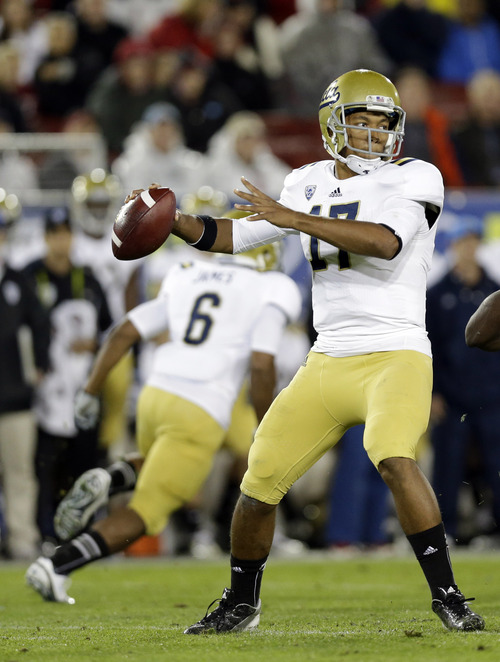 UCLA quarterback Brett Hundley throws against Stanford during the first half of the Pac-12 championship NCAA college football game in Stanford, Calif., Friday, Nov. 30, 2012. (AP Photo/Marcio Jose Sanchez)