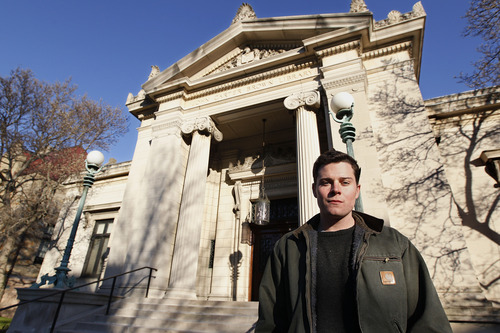 In this Thursday, Nov. 29, 2012 photo, Lucas Mason-Brown, a senior mathematics major at Brown University who helped crack a mysterious shorthand code developed and used by religious dissident Roger Williams in the 17th century, stands for a photo outside the John Carter Brown Library on the university's campus in Providence, R.I. (AP Photo/Stephan Savoia)