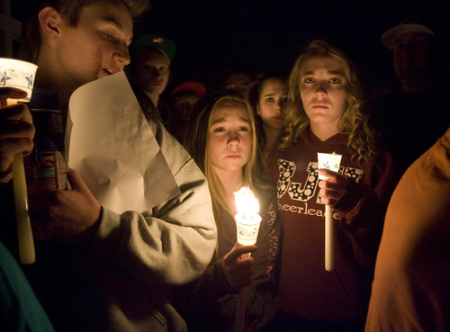 Kim Raff  |  The Salt Lake Tribune  Students mourn during a vigil for a 14-year-old boy who committed suicide on a pedestrian bridge near Bennion Junior High School in Taylorsville on Nov. 29, 2012.