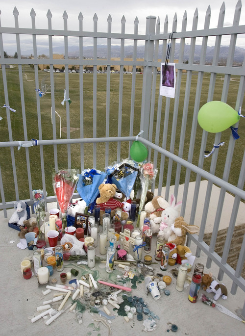 Paul Fraughton  |  The Salt Lake Tribune A photo and rosary hang Friday above a small memorial shrine on the pedestrian walkway at 6200 South and 2700 West, where a 14-year-old fatally shot himself Thursday.