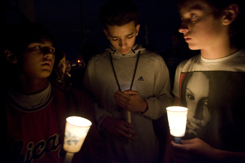 Kim Raff  |  The Salt Lake Tribune (from left) Junior Estrada, Anthony McQuiston and Brandon Newby stand on the pedestrian bridge during a vigil for a 14-year-old student who committed suicide there near Bennion Junior High School in Taylorsville on Nov. 29, 2012.  The boys were all childhood friends with the student.